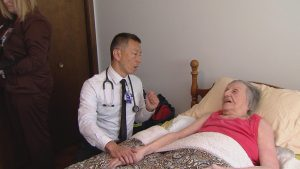 physician treating a patient in their home