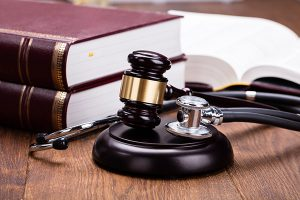 Stethescope, judge's mallet and legal books