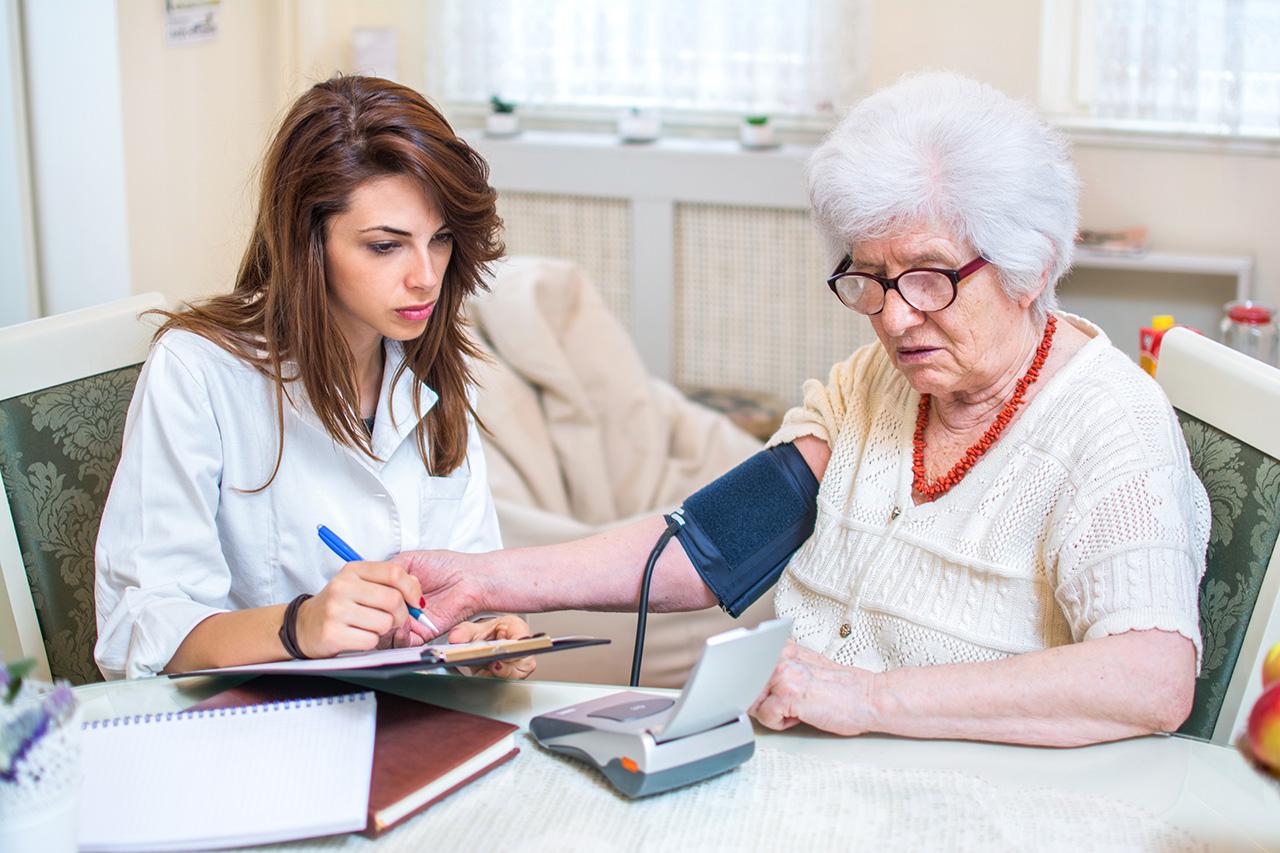 Nurse Practioner checking patient's blood pressure