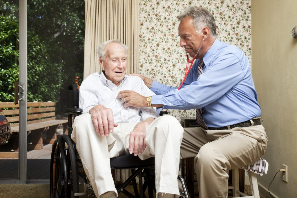 Doctor making a house call on an elderly man