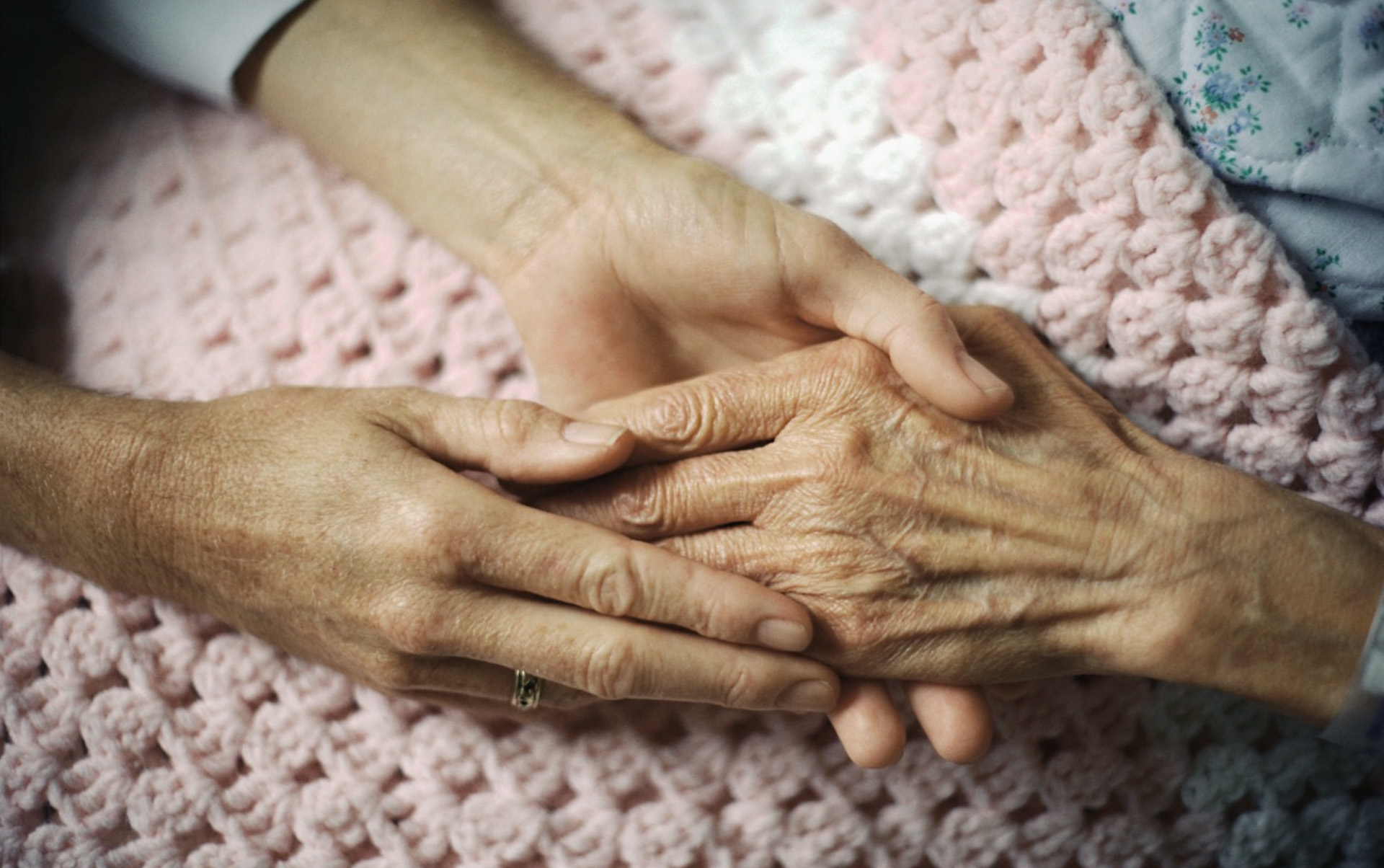 holding hand of elderly patient