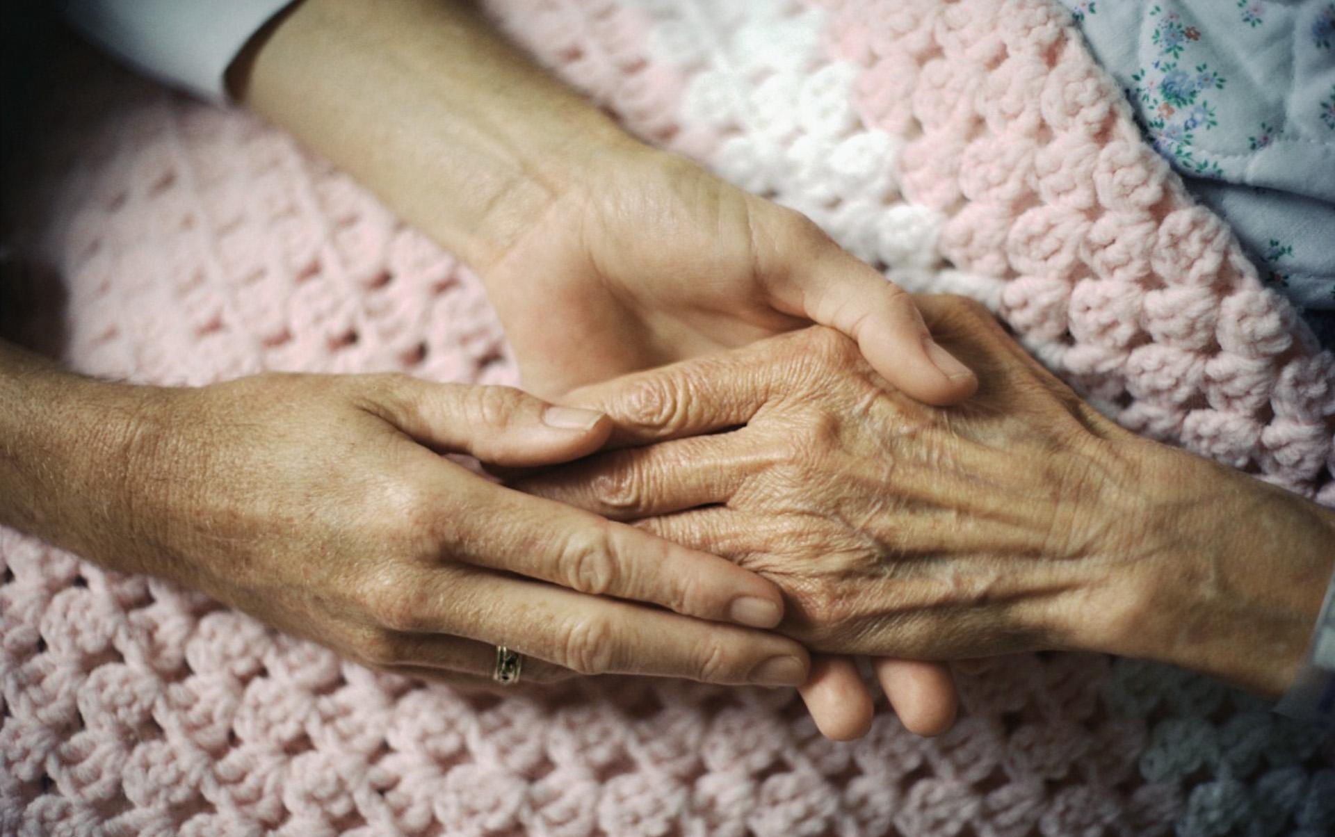 holding hand of elderly patient
