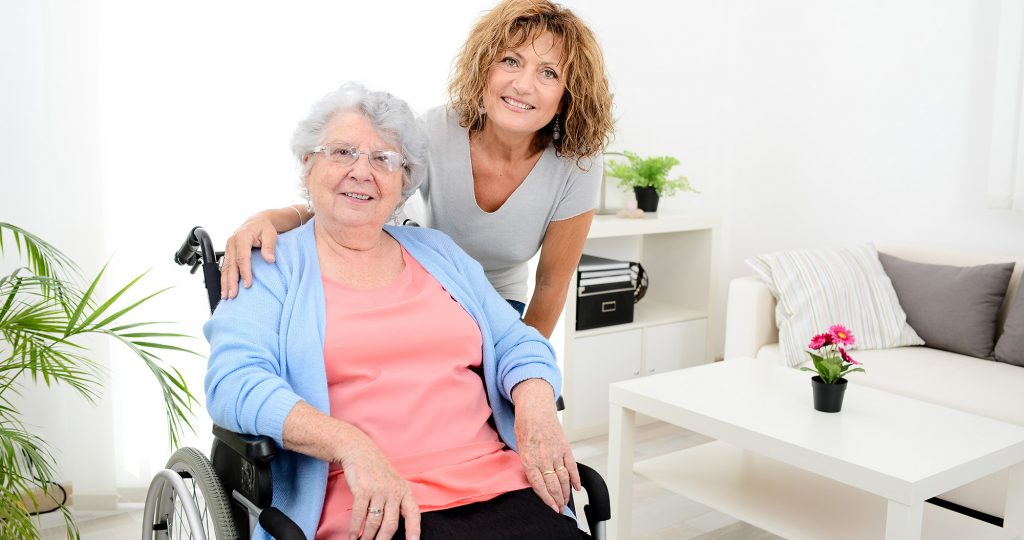 Family caregiver daughter caring for her mom